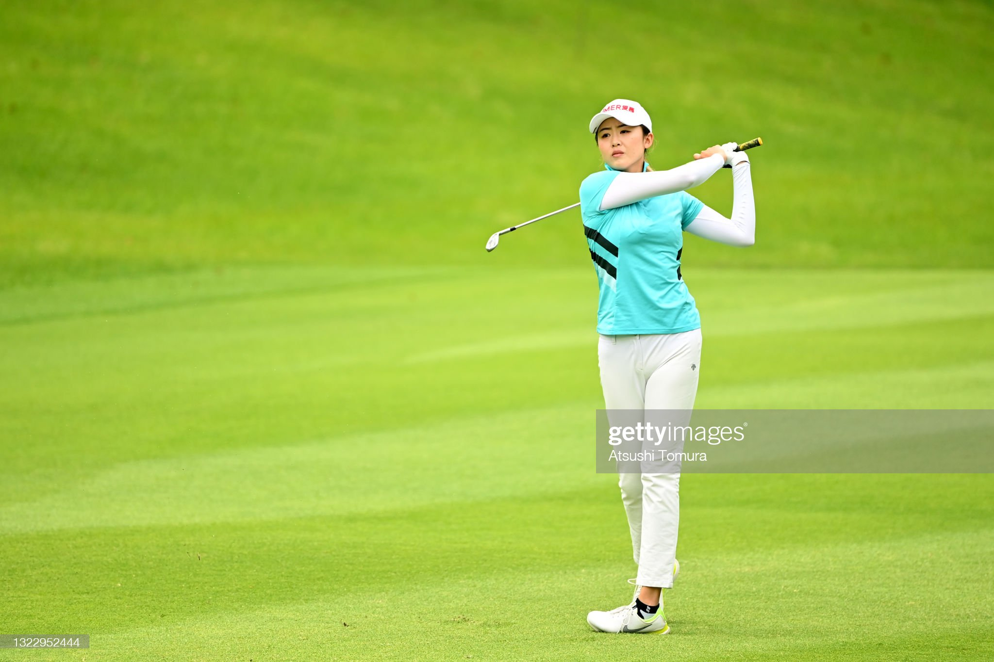 https://media.gettyimages.com/photos/simin-feng-of-china-hits-her-second-shot-on-the-9th-hole-during-the-picture-id1322952444?s=2048x2048