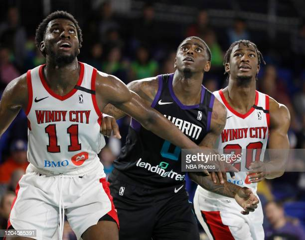 Simisola Shittu and Adam Mokoka, both of the Windy City Bulls block out Dwayne Bacon of the Greensboro Swarm during a G League game at the Greensboro...