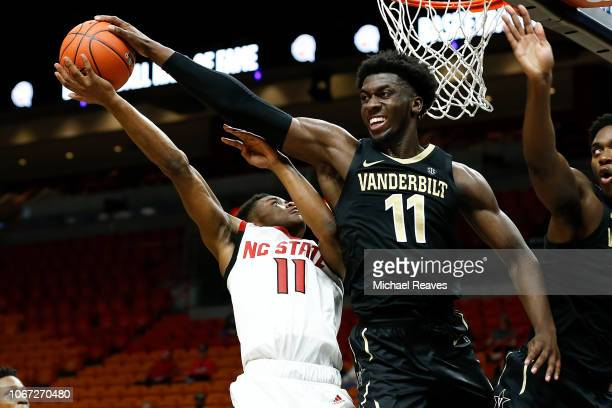 Simisola Shittu of the Vanderbilt Commodores blocks a shot by Markell Johnson of the North Carolina State Wolfpack during the HoopHall Miami...