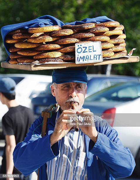 Simit seller on the streets of Ankara Simit or gevrek is a circular bread typically encrusted with sesame seeds or less commonly poppy or sunflower...