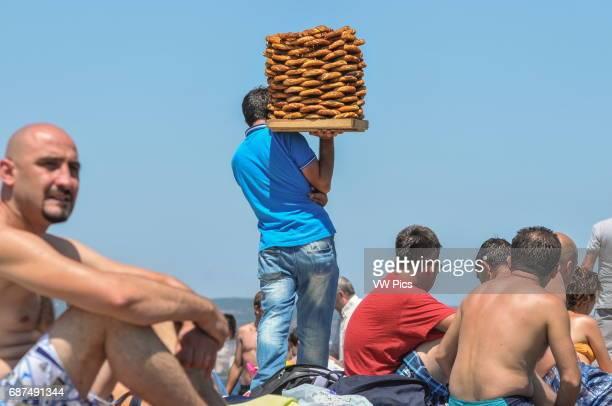 A simit vendor walks among sunbathers on BÙyÙkada the largest of the Princes' Islands off the coast of Istanbul
