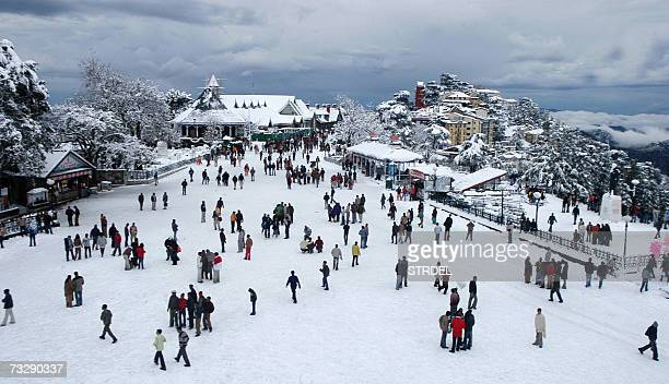 People meander through the snow following a snow-fall in the hill station of Shimla in the northern state of Himachal Pradesh, 11 February 2007....