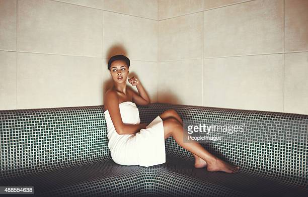 simmering down in the sauna - black woman in sauna stock pictures, royalty-free photos & images