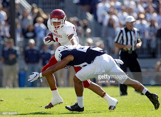 Simmie Cobbs Jr #1 of the Indiana Hoosiers is tackled by John Reid of the Penn State Nittany Lions in the first half during the game on October 10...