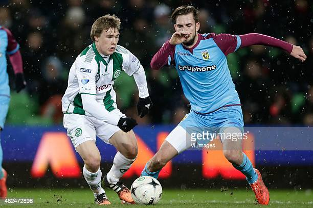 Simmon Tibbling of FC Groningen Davy Propper of Vitesse during the Dutch Cup match between FC Groningen and Vitesse Arnhem at Euroborg on January 28...
