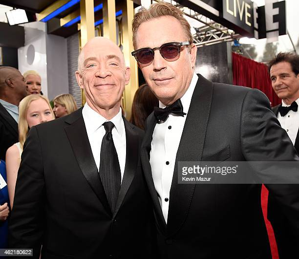 K Simmons and Kevin Costner attend TNT's 21st Annual Screen Actors Guild Awards at The Shrine Auditorium on January 25 2015 in Los Angeles California...