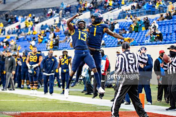 Simmons and Sam James of the West Virginia Mountaineers celebrate in the first half after a touchdown during a game against the Army Black Nights at...