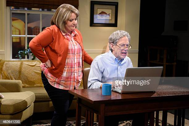 LIVE JK Simmons Episode 1675 Pictured Aidy Bryant as Ruth and JK Simmons as Cam and during the Microsoft Assistant skit on January 31 2015