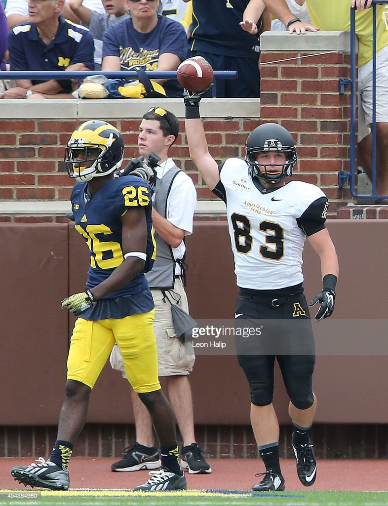 Simms McElfresh #83 of Appalachin State celebrates after scoring a second half touuchdown pass from quarterback Kameron Bryant (not in photo) during the game against the Michigan Wolverines at Michigan Stadium on August 30, 2014 in Ann Arbor, Michigan. The Wolverines defeated the Mountaineers 52-14.