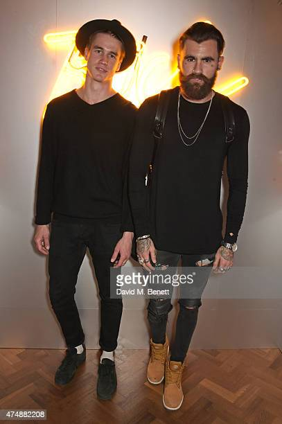 Simo Kirk and Chris Perceval attend the launch of Veuve Clicquot RICH hosted by Solange Knowles at Cafe Royal on May 27 2015 in London England