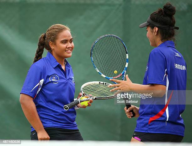 Simoana Reupena and Lyla Tapusoa of Samoa talk tactics as they play against Rebekah O'Loughlin and Joely Lomas of Wales in the Girls Doubles Tennis...