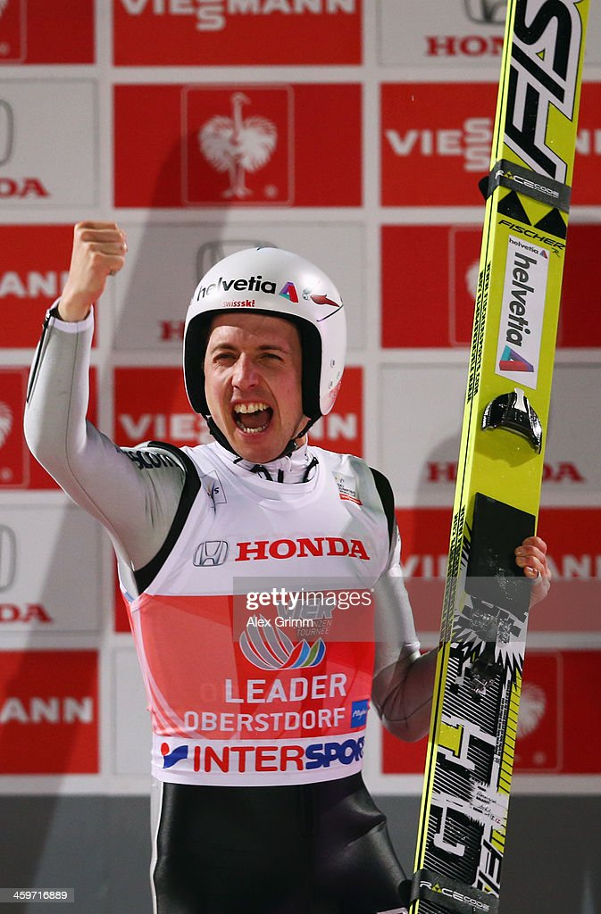 Simon Amman of Switzerland celebrates after winning the Four Hills Tournament Ski Jumping event at Schattenberg-Schanze on December 29, 2013 in Oberstdorf, Germany.