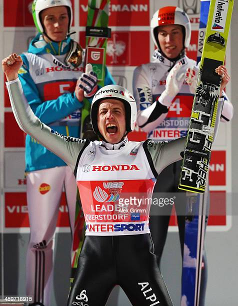Simon Amman of Switzerland celebrates after winning the Four Hills Tournament Ski Jumping event at SchattenbergSchanze on December 29 2013 in...