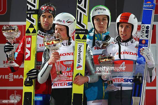 Simon Amman of Switzerland celebrates after winning the Four Hills Tournament Ski Jumping event ahead of second placed Anders Bardal of Norway and...