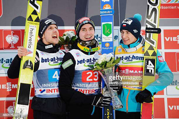 Simon Ammann of Switzerland Anssi Koivuranta of Finland and Kamil Stoch of Poland pose at the podium after the competition on day 2 of the Four Hills...