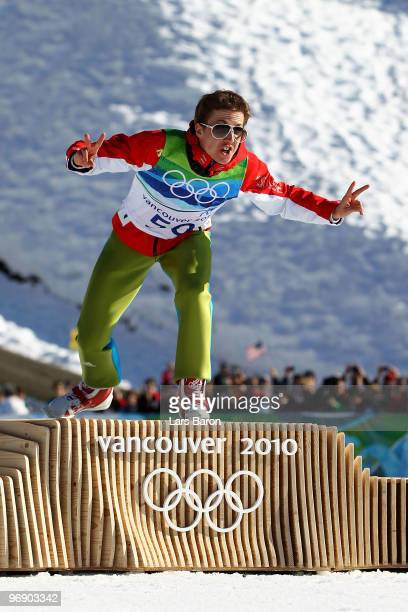 Simon Ammann of Switzerland celebrates after winning the Gold medal on the Large Hill during day 9 of the 2010 Vancouver Winter Olympics at Ski...