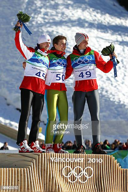 Simon Ammann of Switzerland celebrates his Gold medal Adam Malysz of Poland Silver and Gregor Schlierenzauer of Austria after the final jump the...