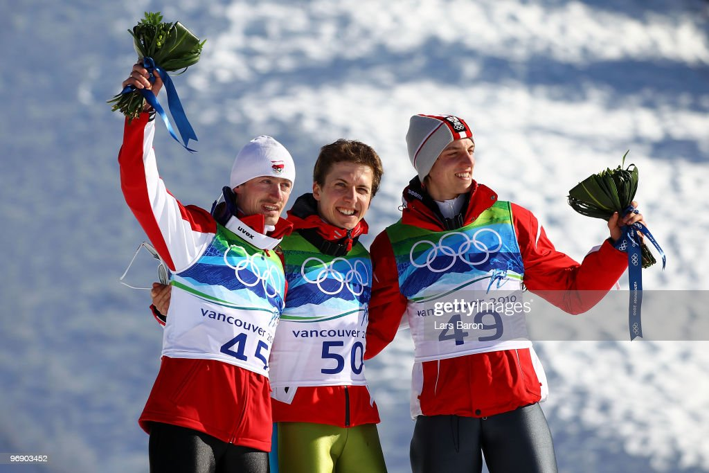 Simon Ammann of Switzerland (C) celebrates his Gold medal, Adam Malysz (L) of Poland Silver and Gregor Schlierenzauer (R) of Austria Bronze after the final jump the Large Hill on day 9 of the 2010 Vancouver Winter Olympics at Ski Jumping Stadium on February 20, 2010 in Whistler, Canada.
