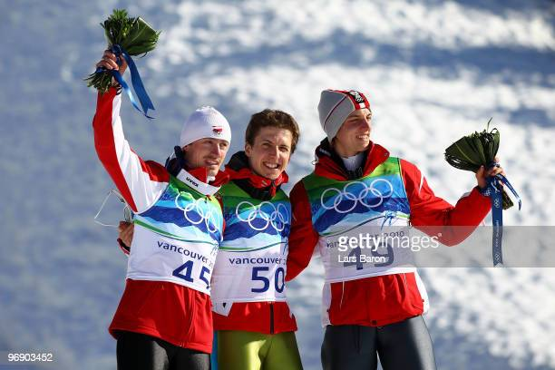 Simon Ammann of Switzerland celebrates his Gold medal Adam Malysz of Poland Silver and Gregor Schlierenzauer of Austria Bronze after the final jump...