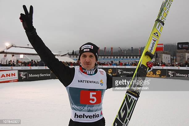 Simon Ammann of Switzerland celebrates winning the FIS Ski Jumping World Cup event at the 59th Four Hills ski jumping tournament at Olympiaschanze on...