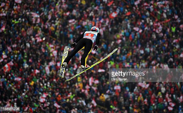 Simon Ammann of Switzerland competes during the first round for the FIS Ski Jumping World Cup event of the 61st Four Hills ski jumping tournament at...