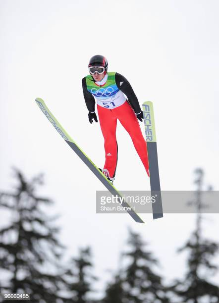 Simon Ammann of Switzerland competes during the Ski Jumping Normal Hill Individual Trial Round on day 2 of the Vancouver 2010 Winter Olympics at...