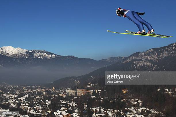 Simon Ammann of Switzerland competes during the trial round for the FIS Ski Jumping World Cup event at the 59th Four Hills ski jumping tournament at...