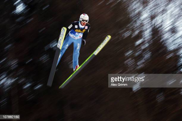 Simon Ammann of Switzerland competes during training round for the FIS Ski Jumping World Cup event of the 59th Four Hills ski jumping tournament at...