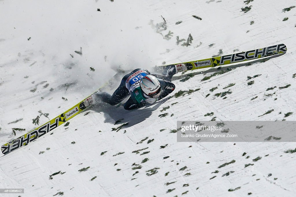 Simon Ammann of Switzerland falls during the FIS Ski Jumping World Cup Vierschanzentournee (Four Hills Tournament) on January 06, 2015 in Bischofhofen, Austria.