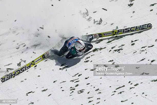 Simon Ammann of Switzerland falls during the FIS Ski Jumping World Cup Vierschanzentournee on January 06 2015 in Bischofhofen Austria