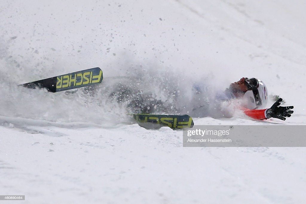 Simon Ammann of Switzerland falls on his first round jump on day 2 of the Four Hills Tournament Ski Jumping event at Schattenberg-Schanze Erdinger Arena on December 29, 2014 in Oberstdorf, Germany.