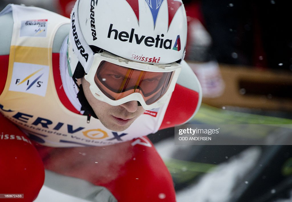 Simon Ammann of Switzerland jumps during the training run at the FIS Ski Jumping World Cup on the Muehlenkopfschanze hill in Willingen, western Germany, on February 8, 2013. Heavy snowfall made the conditions challenging for the athletes.