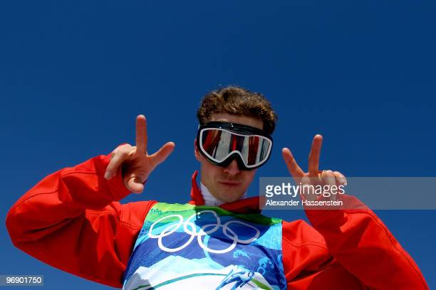 Simon Ammann of Switzerland poses for a photo after completing a jump on the Large Hill during day 9 of the 2010 Vancouver Winter Olympics at Ski...