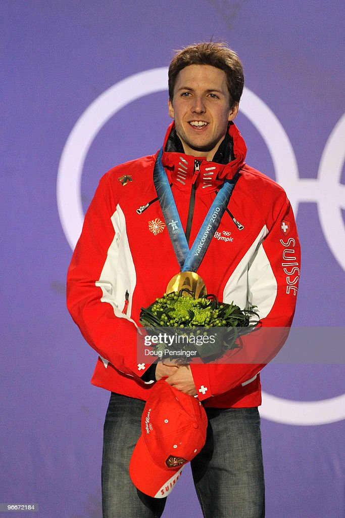 Simon Ammann of Switzerland poses with his gold medal during the Medal Ceremony for the Ski Jumping Normal Hill Individual on day 2 of the Vancouver 2010 Winter Olympics at Whistler Medals Plaza on February 13, 2010 in Whistler, Canada.