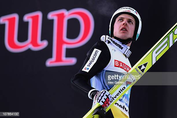 Simon Ammann of Switzerland reacts after his second jump during the FIS Ski Jumping World Cup event of the 59th Four Hills ski jumping tournament at...