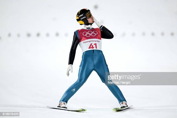 Simon Ammann of Switzerland reacts after landing a jump during the Ski Jumping Men's Large Hill Individual Qualification at Alpensia Ski Jumping...