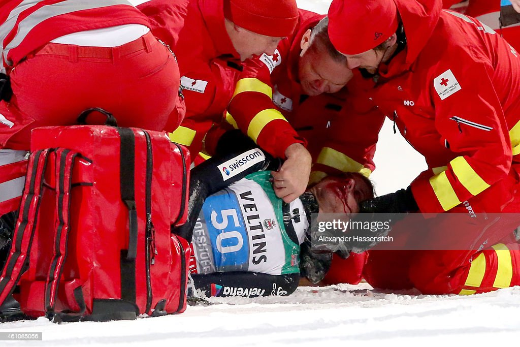 Simon Ammann of Switzerland receives medical treatment after his crash on day 8 of the Four Hills Tournament Ski Jumping event at Paul-Ausserleitner-Schanze Sepp-Bradl-Stadion on January 6, 2015 in Bischofshofen, Austria.