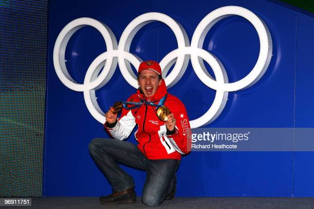 Simon Ammann of Switzerland receives the gold medal during the medal ceremony for the men's large hill individual ski jumping held at the Whistler...