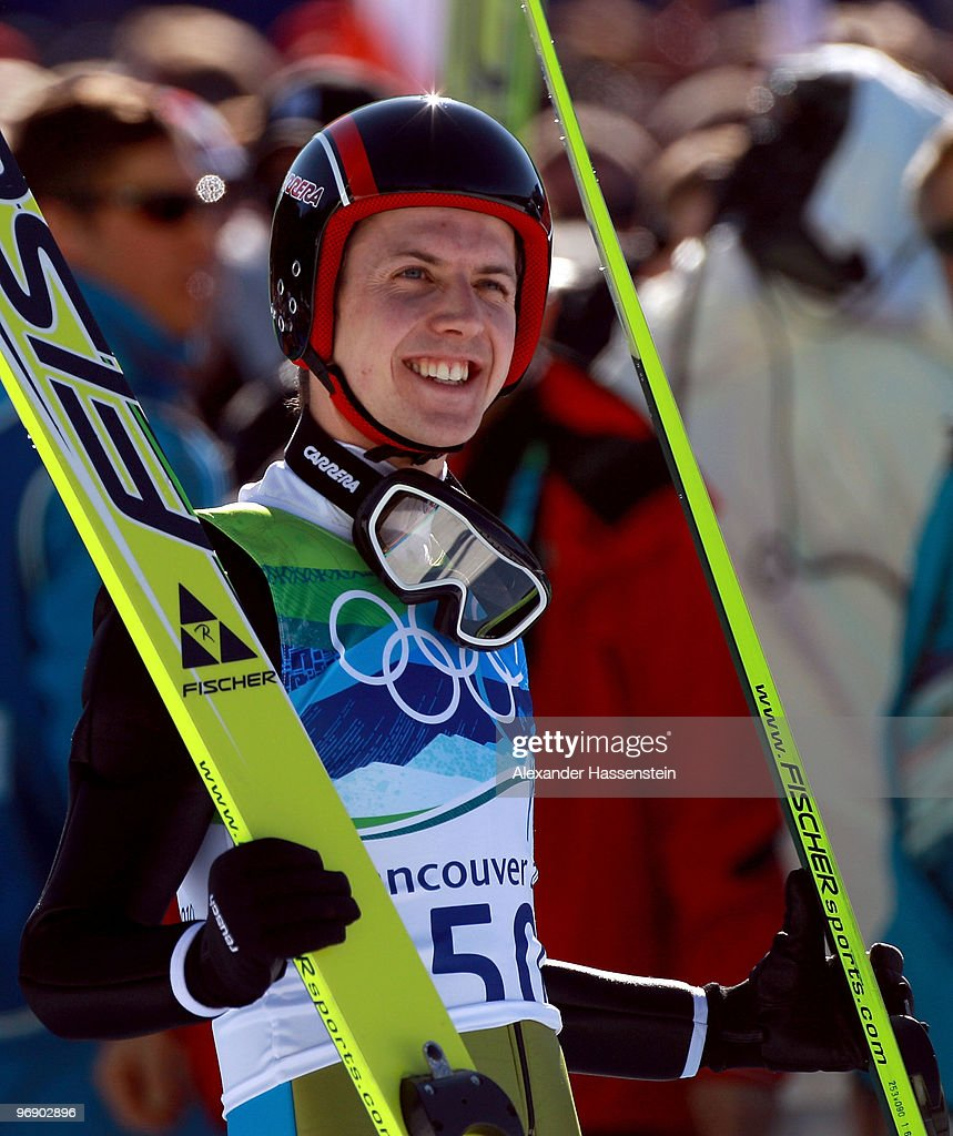 Simon Ammann of Switzerland smiles after coming to a landing on the final jump the Large Hill on day 9 of the 2010 Vancouver Winter Olympics at Ski Jumping Stadium on February 20, 2010 in Whistler, Canada.