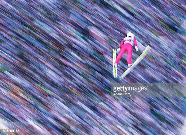Simon Ammann of Switzerland soars through the air and over the grandstand during his final competition jump on day 2 of the Innsbruck 64th Four Hills...