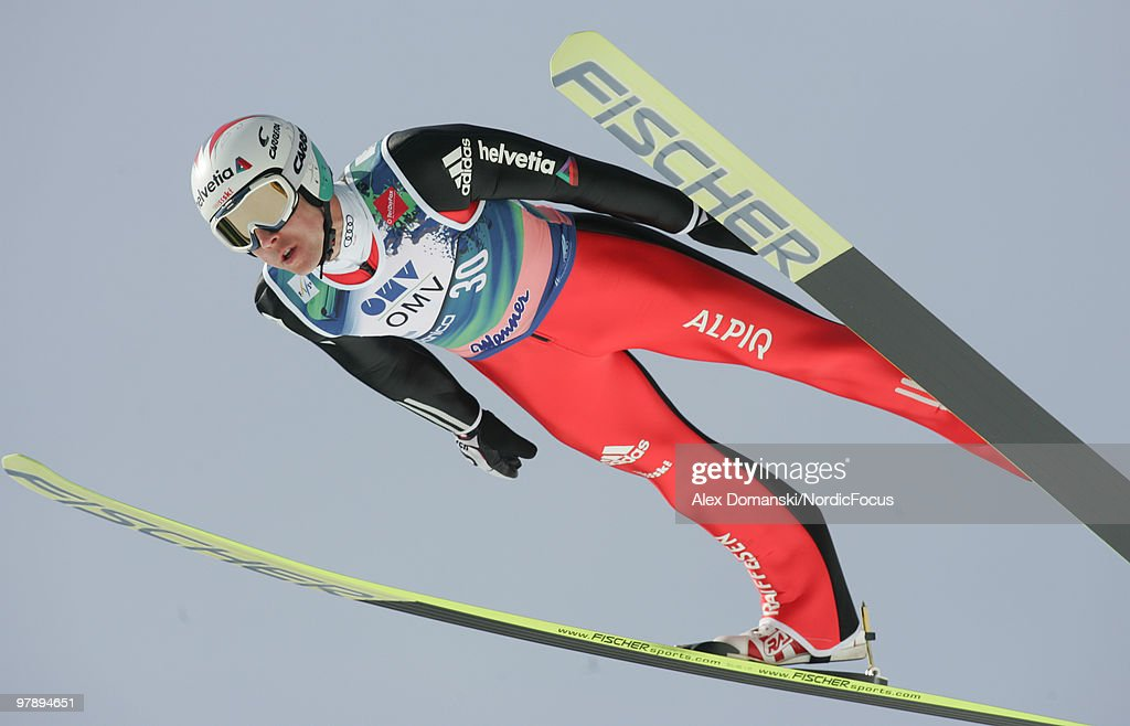 Simon Ammann of Switzerland soars through the air during the individual event of the Ski jumping World Championships on March 20, 2010 in Planica, Slovenia.