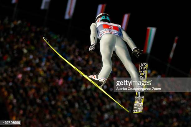 Simon Ammann of Switzerland takes 1st place during the FIS Ski Jumping World Cup Vierschanzentournee on December 29 2013 in Oberstdorf Germany