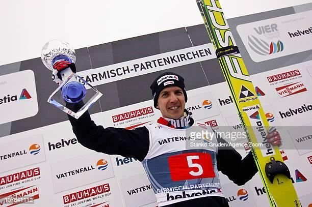 Simon Ammann of Switzerland takes 1st place the FIS Ski Jumping World Cup Vierschanzentournee on January 1 2011 in GarmischPartenkirchen Germany