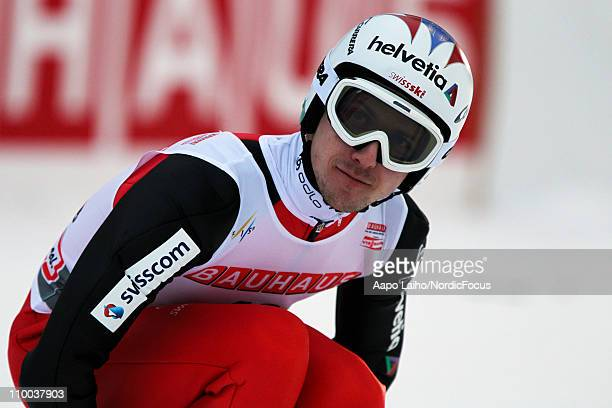 Simon Ammann of Switzerland waits for the results in the large hill HS130 during the FIS Ski Jumping World Cup on March 13 in Lahti Finland