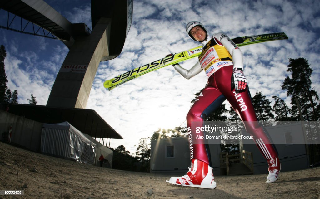 Simon Ammann of Switzerland walks up the jumping hill for the final round of the FIS Ski Jumping World Cup event of the 58th Four Hills ski jumping tournament on January 3, 2010 in Innsbruck, Austria.