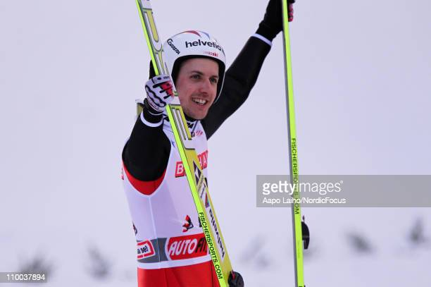 Simon Ammann of Switzweland celebrates the victory in the large hill HS130 during the FIS Ski Jumping World Cup on March 13 in Lahti Finland