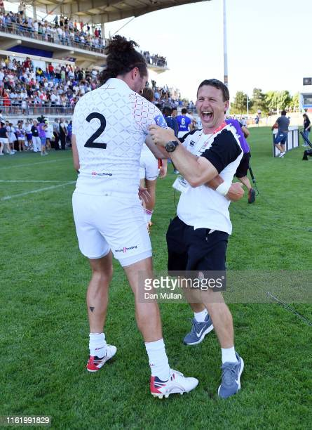 Simon Armor Head of England Sevens celebrates with Mike Ellery of England following their victory and qualification to the Tokyo 2020 Olympic Games...