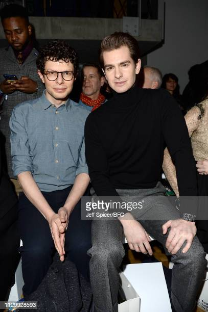 Simon Amstell and Andrew Garfield attend the Central Saint Martins MA show during London Fashion Week February 2019 on February 15 2019 in London...