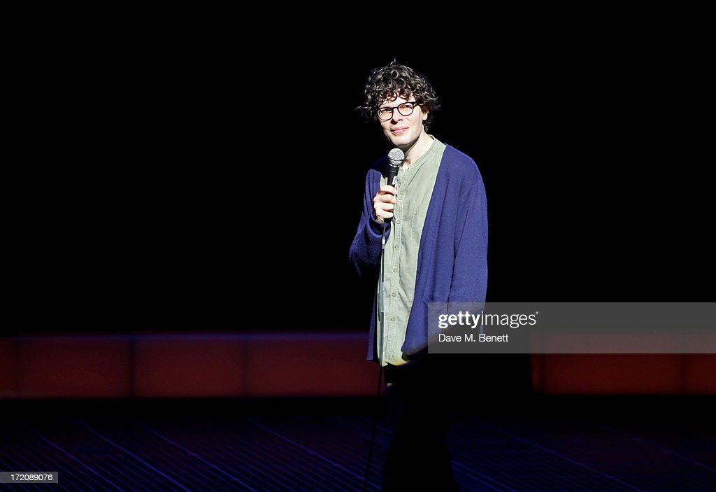 Simon Amstell performs on stage at 'A Curious Night at the Theatre', a charity gala evening to raise funds for Ambitious about Autism and The National Autistic Society, at The Apollo Theatre on July 1, 2013 in London, England.