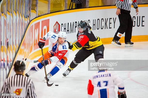 Simon Backman of Lappeenranta challenges Jukka Peltola of Tampere during the Champions Hockey League Round of 32 match between SaiPa Lappeenranta and...